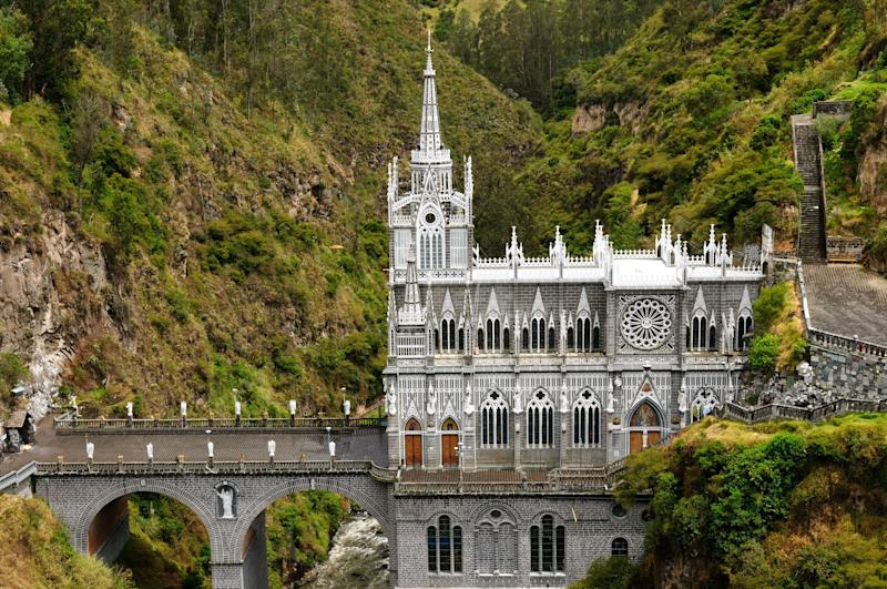 "Located near the border of Colombia and Ecuador, the Las Lajas Sanctuary is undoubtedly one of the most beautiful basilicas in the world. The precarious gothic revival structure is built into the canyon of the Guaitara River, connecting the two banks. The church was constructed in honor of <a href=""http://www.atlasobscura.com/places/las-lajas-sanctuary"" target=""_blank"">two legendary miracles</a>, and its miraculous location surely pays tribute to these origins."