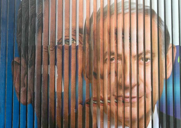 A giant campaign billboard rotates between images of Israeli Prime Minister and Likud candidate Benjamin Netanyahu (R) and co-leader of the Zionist Union party, Isaac Herzog, in Tel Aviv (AFP Photo/Gil Cohen Magen)