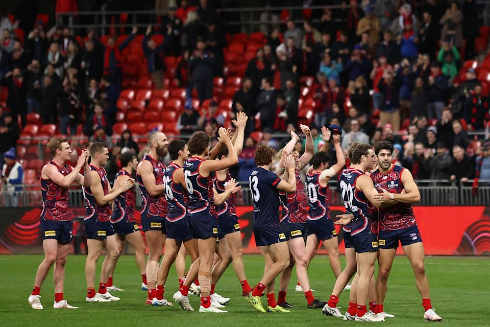 The Demons wave to the crowd after winning the round 12 AFL match between the Melbourne Demons and the Brisbane Lions at GIANTS Stadium on June 04, 2021 in Sydney, Australia.