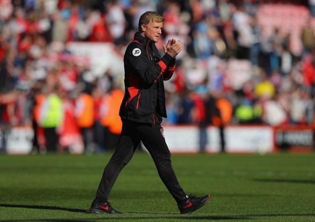 Eddie Howe applauds the fans after a convincing win