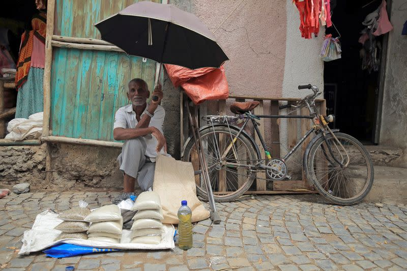 A vendor waits for his customers in a local market of Humera town