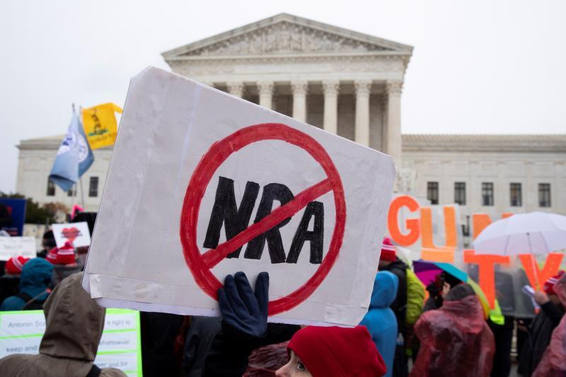 People for gun control laws rally outside the Supreme Court while the court hears oral arguments for the case New York State Rifle and Pistol Association Inc. v. City of New York, New York; in Washington, DC, USA, 02 December 2019. EFE/Michael Reynolds