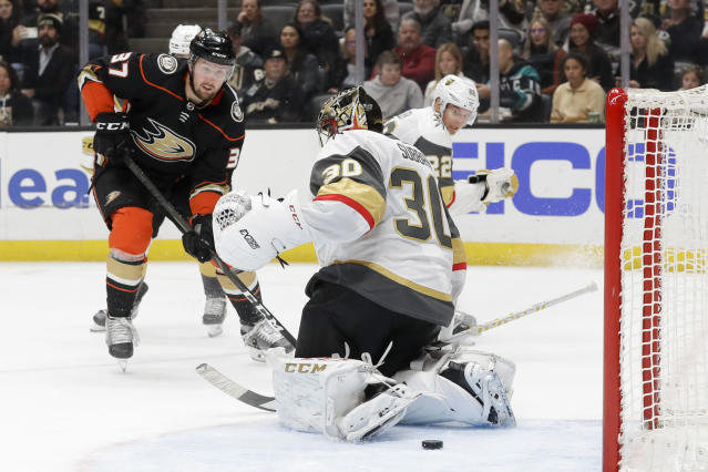 Anaheim Ducks left wing Nick Ritchie, left, scores past Vegas Golden Knights goaltender Malcolm Subban nduring the second period of an NHL hockey game in Anaheim, Calif., Sunday, Feb. 23, 2020. (AP Photo/Chris Carlson)