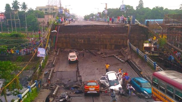 <p>The bridge that partially collapsed in South Kolkata's Majherhat area toppling some vehicles including two- and four-wheelers on Sept 4, 2018. (Photo: IANS) </p>