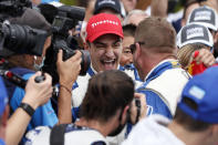 NTT IndyCar Series winner Alex Palou, center, celebrates with a team member after taking 4th place in an IndyCar auto race at Grand Prix of Long Beach, Sunday, Sept. 26, 2021, in Long Beach, Calif. (AP Photo/Alex Gallardo)