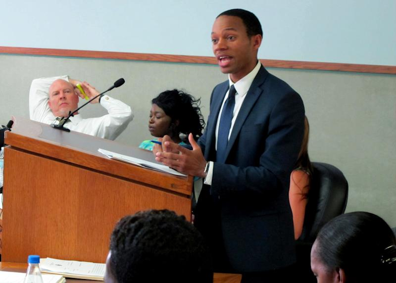 Prosecutor Eric Cook gives his closing arguments to a jury in the trial of Precious Allen, 31, seated behind him with her defense attorney, in the Hamilton County Court of Common Pleas in Cincinnati, Ohio Friday Aug. 23, 2013. Allen has pleaded not guilty to misdemeanor assault and aggravated trespassing in a Feb. 7, 2013, classroom brawl in which she's accused of hitting and holding down a 15-year-old girl while her teenage daughter hit her in the face with a combination lock. (AP Photo/Amanda Lee Myers)