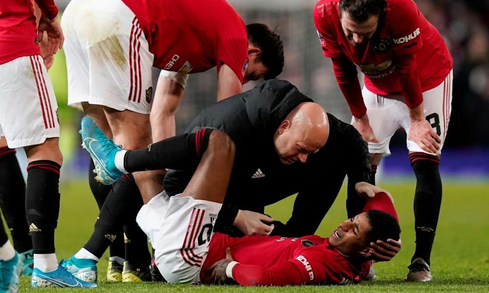 Rashford receiving medical attention after being injured while playing against Wolverhampton at Old Trafford, Manchester.
