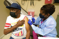 Wilbert Marshall, 71, looks away while receiving a COVID-19 vaccine, from Melissa Banks, right, a nurse at the Aaron E. Henry Community Health Service Center in Clarksdale, Miss., Wednesday, April 7, 2021. Marshall was among a group of seniors from the Rev. S.L.A. Jones Activity Center for the Elderly who received a vaccination. The Mississippi Department of Human Services is in the initial stages of teaming up with community senior services statewide to help older residents get vaccinated. (AP Photo/Rogelio V. Solis)
