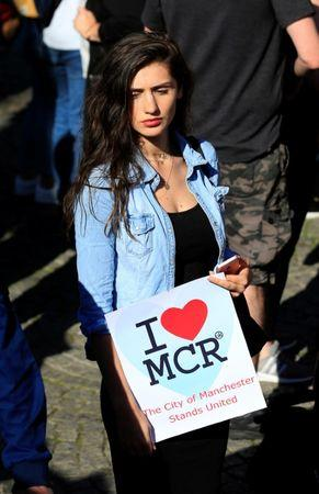 A woman waits to take part in a vigil for the victims of an attack on concert goers at Manchester Arena, in central Manchester, Britain May 23, 2017. REUTERS/Jon Super