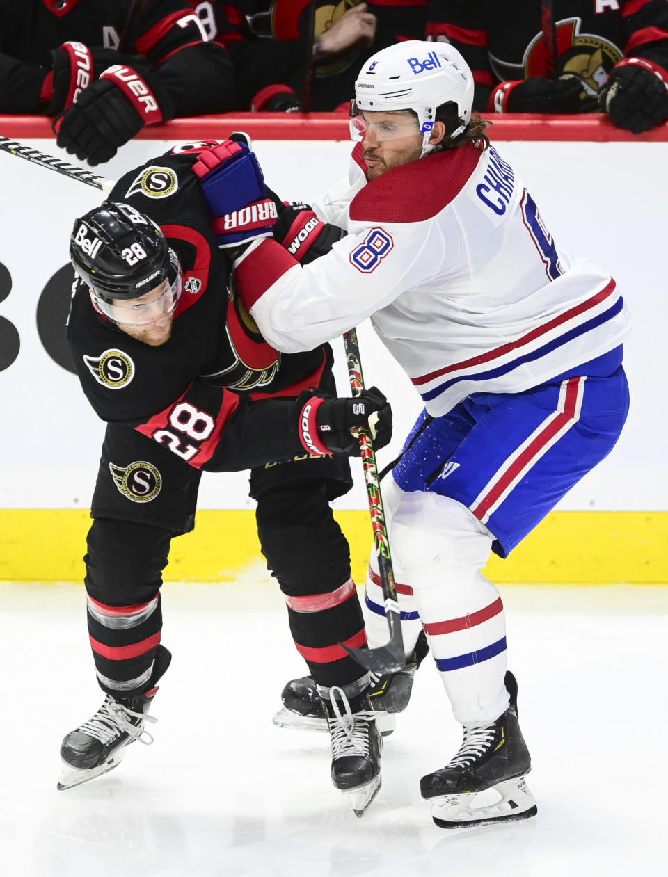 Ottawa Senators' Connor Brown, left, is hit by Montreal Canadiens' Ben Chiarot during the third period of an NHL hockey game, Wednesday, May 5, 2021 in Ottawa, Ontario. (Sean Kilpatrick/The Canadian Press via AP)