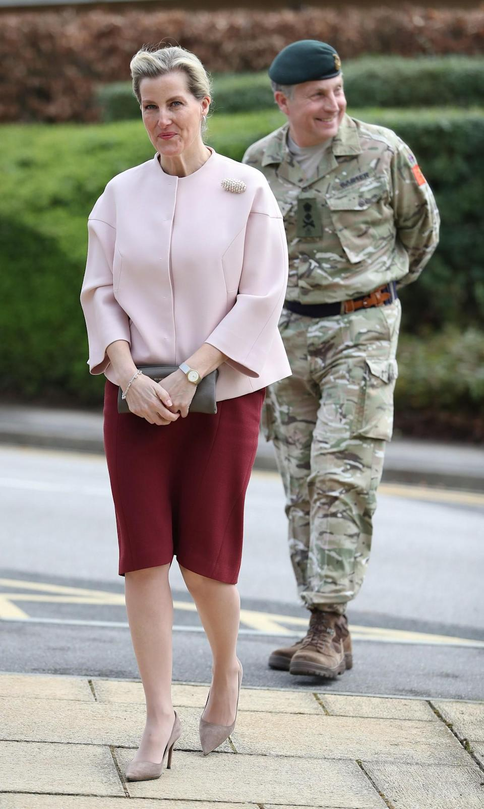 <p>Working an oversized light pink jacket and deep red skirt with matching lipstick in March [Photo: PA]<br><br><br></p>