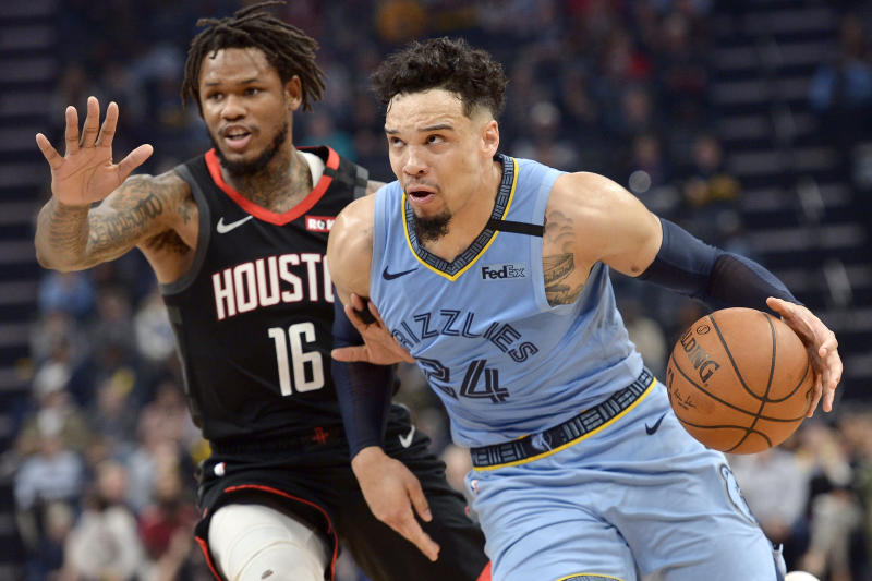 Memphis Grizzlies guard Dillon Brooks (24) drives next to Houston Rockets guard Ben McLemore during the second half of an NBA basketball game Tuesday, Jan. 14, 2020, in Memphis, Tenn. (AP Photo/Brandon Dill)