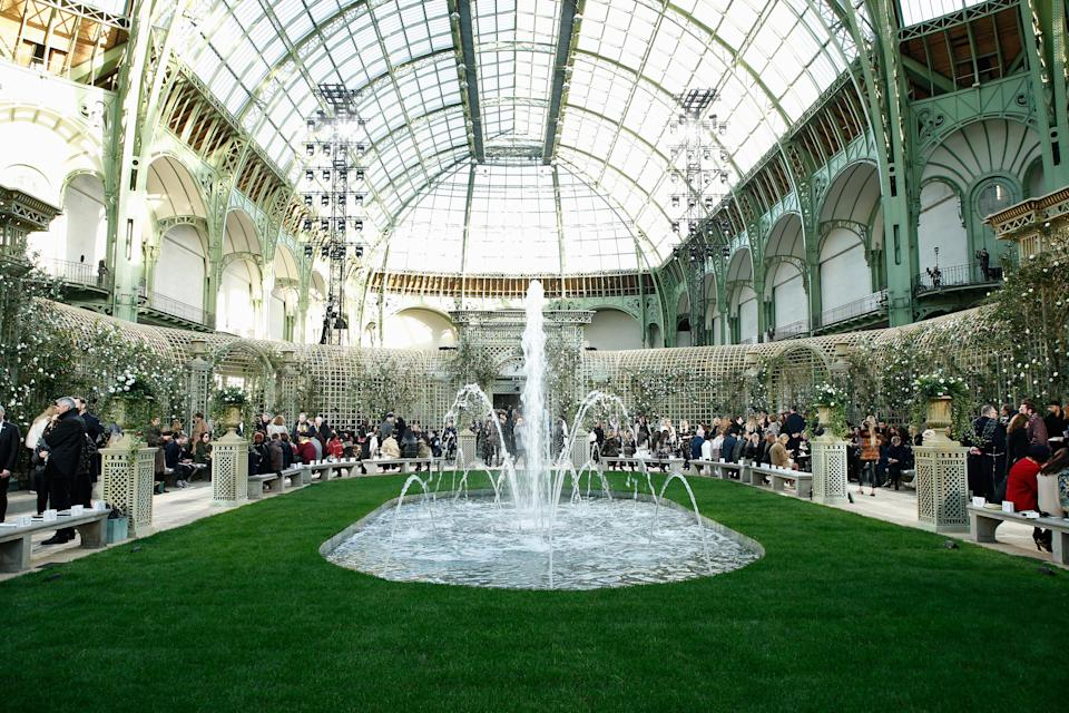 <p>Proving that he can in fact (sometimes) do subtle, Karl Lagerfeld created a quintessentially English garden for the SS18 couture show. Thousands of powder pink flowers grew from faux walls while models stepped out in ladylike tweed sets with floral headpieces atop their heads. <em>[Photo: Getty]</em> </p>