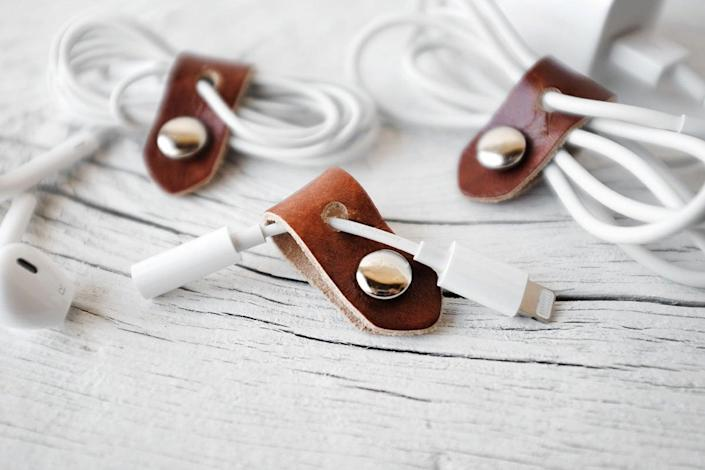 <p>Keep all your cords in order with this <span>Exsect Leather iPhone Cord Organizer</span> ($5, originally $6).</p>