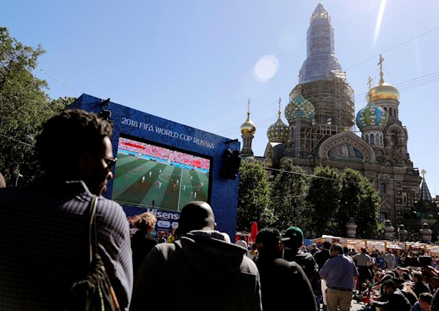 Soccer Football - World Cup - Group B - Portugal vs Morocco - Saint Petersburg, Russia - June 20, 2018. Fans watch the broadcast at Saint Petersburg Fan Fest. REUTERS/Henry Romero