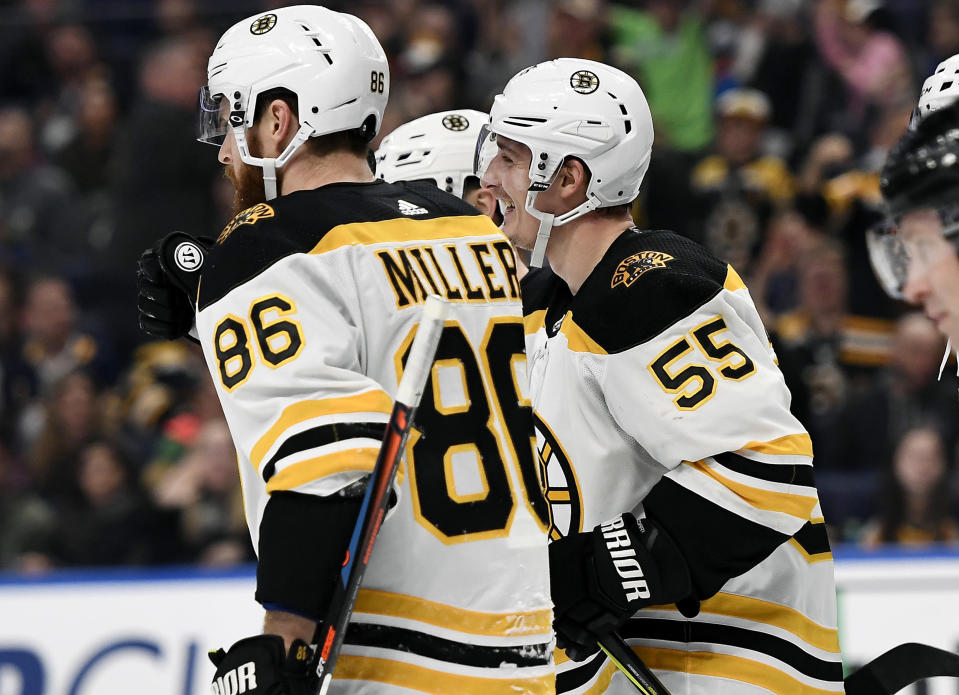 Boston Bruins center Noel Acciari (55) celebrates his goal with defenseman Kevan Miller (86) during the first period of an NHL hockey game against the Buffalo Sabres in Buffalo, N.Y., Saturday, Dec. 29, 2018. (AP Photo/Adrian Kraus)