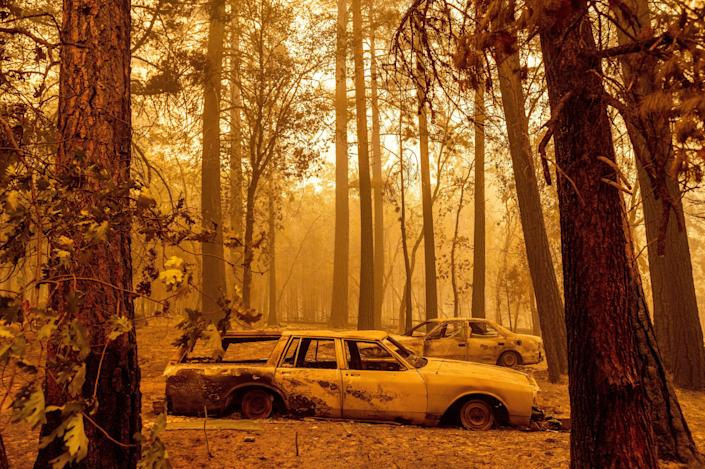 Fire scorched cars in a clearing in the Indian Falls community of Plumas County, Calif., on July 25.