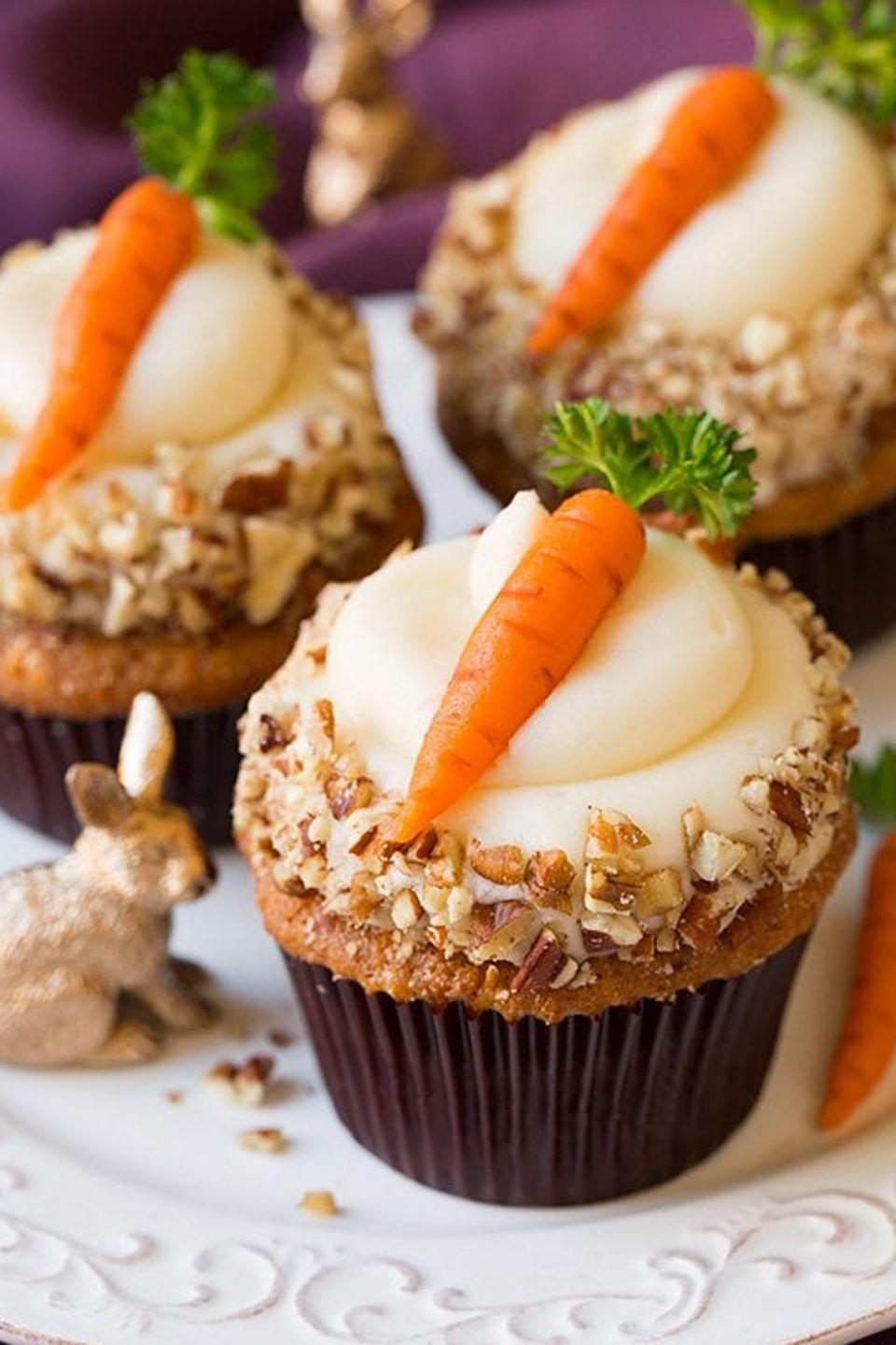 """<p>Although they look real (look at that detail!), these carrot toppers are made with marzipan and parsley stems. That's one way to surprise your guests. </p><p>Get the full recipe from <a href=""""https://www.cookingclassy.com/carrot-cake-cupcakes-cream-cheese-frosting/"""" rel=""""nofollow noopener"""" target=""""_blank"""" data-ylk=""""slk:Cooking Classy"""" class=""""link rapid-noclick-resp"""">Cooking Classy</a> </p>"""
