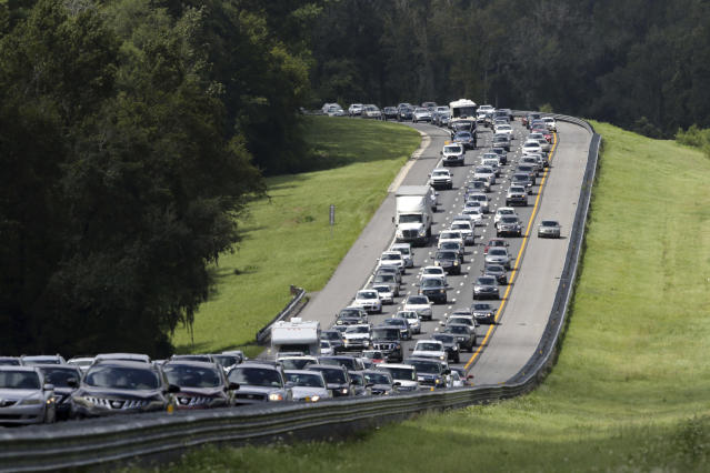 <p>A car rides in the shoulder to pass other cars in evacuation traffic on I-75 N, near Brooksville, Fla., in advance of Hurricane Irma, Saturday, Sept. 9, 2017. (Photo: Gerald Herbert/AP) </p>