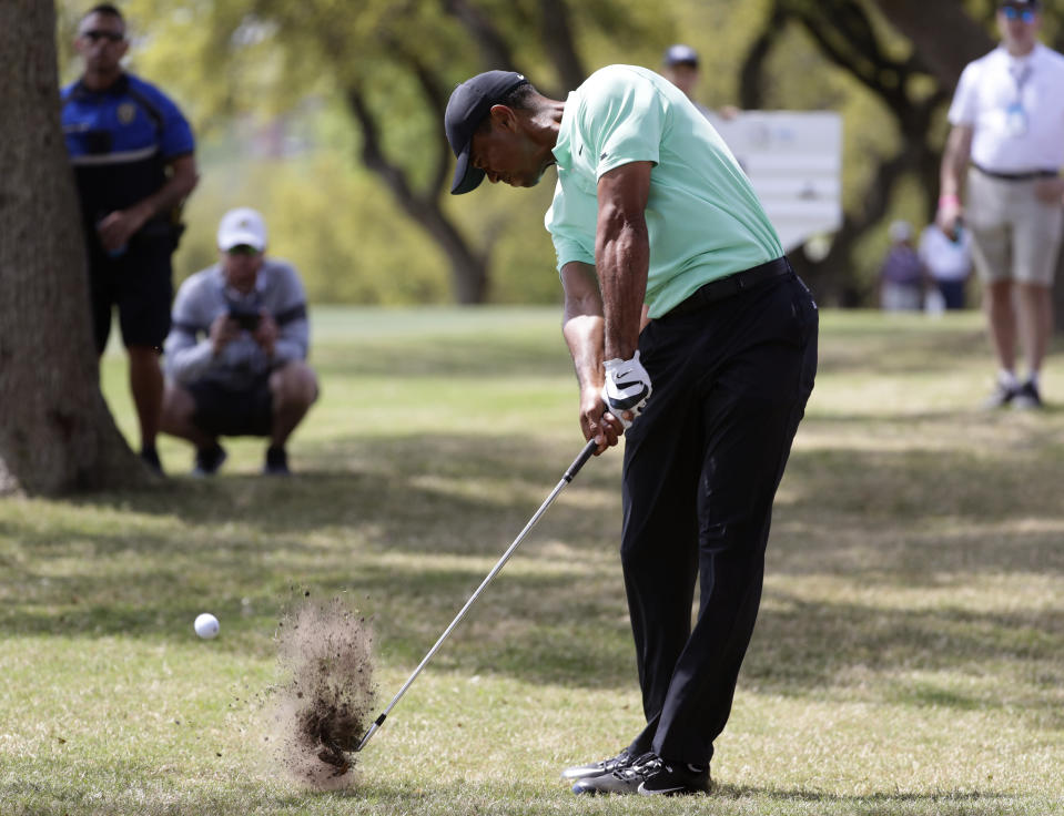 Tiger Woods hits from the rough on the sixth hole during round-robin play at the Dell Match Play Championship golf tournament, Thursday, March 28, 2019, in Austin, Texas. (AP Photo/Eric Gay)