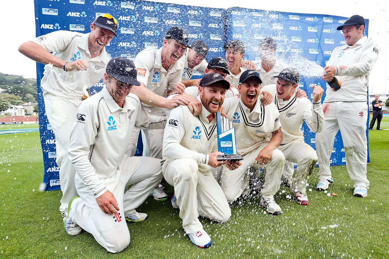 WELLINGTON, NEW ZEALAND - FEBRUARY 18:  Man of the match Brendon McCullum of New Zealand celebrates the test series win with teammates at the conclusion of day five of the 2nd Test match between New Zealand and India on February 18, 2014 in Wellington, New Zealand.  (Photo by Hagen Hopkins/Getty Images)