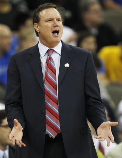 Kansas coach Bill Self yells to his team during the first half of an NCAA college basketball tournament game against Detroit at CenturyLink Center in Omaha, Neb., Friday, March 16, 2012. (AP Photo/Orlin Wagner)