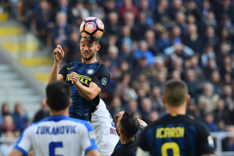 "Inter Milan's midfielder Roberto Gagliardini heads the ball during the Italian Serie A football match Inter Milan vs Atalanta at ""San Siro"" Stadium in Milan on March 12, 2017"