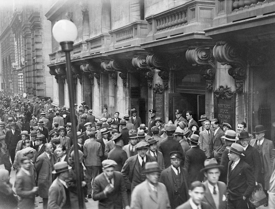 <p>Hoards of bankers, industrial executives, and government officials flocked to the New York Stock Exchange as the nation's stock prices plummeted in the crash of 1929. </p>