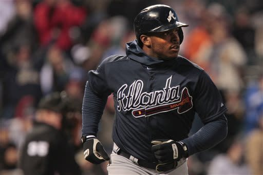 Atlanta Braves left fielder Justin Upton rounds the bases after hitting a home run off Colorado Rockies' starting pitcher Jon Garland during the fifth inning of the second game of a doubleheader Tuesday, April 23, 2013 in Denver. (AP Photo/Barry Gutierrez)