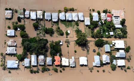 Houses are surrounded by floodwaters brought on by Cyclone Debbie at Depot Hill in Rockhampton, Australia, April 6, 2017.    AAP/Dan Peled/via REUTERS