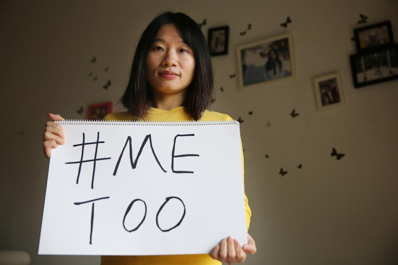 Sophia Huang Xueqin, a freelance journalist, poses with a #MeToo sign at her home. (Photo by Thomas Yau/South China Morning Post via Getty Images)