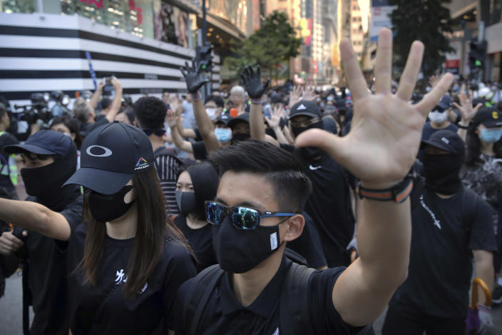Demonstrators wearing masks gather during an anti-government protest in Hong Kong, Saturday, Nov. 2, 2019. Defying a police ban, thousands of black-clad masked protesters are streaming into Hong Kong's central shopping district for another rally demanding autonomy in the Chinese territory as Beijing indicated it could tighten its grip. (AP Photo/Kin Cheung)