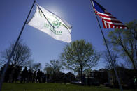 A Tree City USA flag flies in a park during a tree planting ceremony with school children, Friday, April 30, 2021, in Cedar Rapids, Iowa. A rare storm called a derecho plowed through the city of 130,000 last August with 140 mph winds and left behind a jumble of branches, downed powerlines and twisted signs. Now, city officials, businesses and nonprofit groups have teamed up with ambitious plans to somehow transform what is now a city of stumps back into the tree-covered Midwestern oasis along the Cedar River. (AP Photo/Charlie Neibergall)