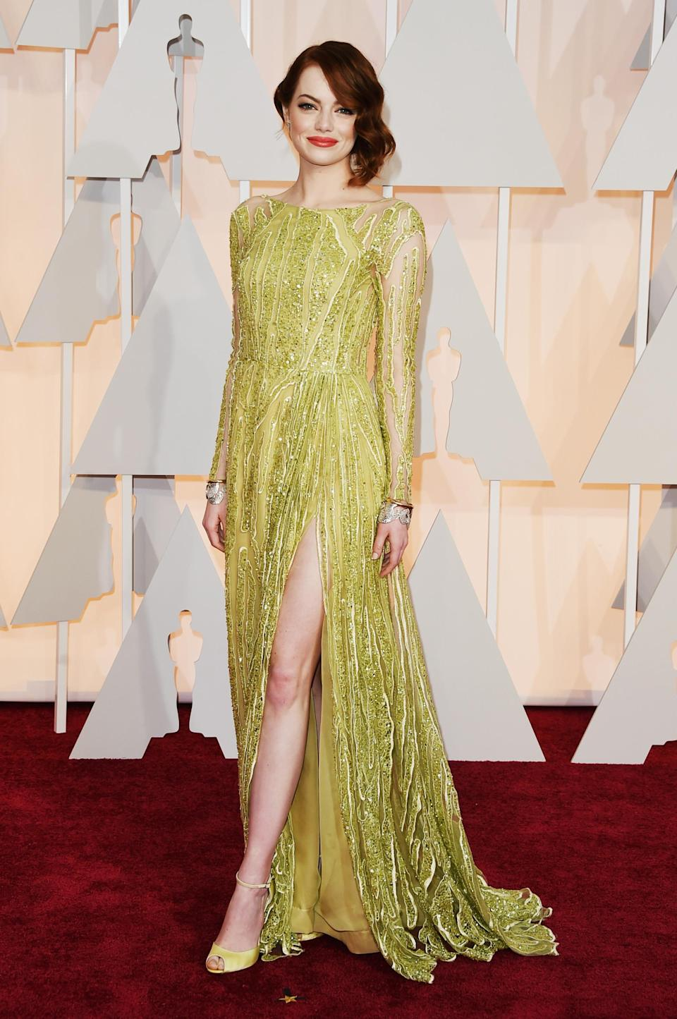 At the 87th Annual Academy Awards in 2015, then up-and-coming star Emma Stone wowed in a beaded green Elie Saab number, complete with thigh-high split.