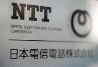 FILE PHOTO: The logo of NTT is displayed at the company office in Tokyo