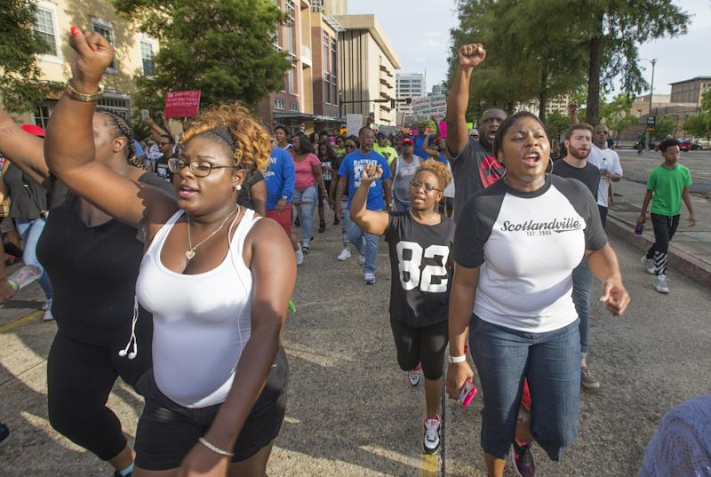 BATON ROUGE, LA - JULY 09: Protesters march from the Baton Rouge City Hall to the Louisiana Capitol to protest the shooting of Alton Sterling on July 9, 2016 in Baton Rouge, Louisiana. Alton Sterling was shot by a police officer in front of the Triple S Food Mart in Baton Rouge on July 5th, leading the Department of Justice to open a civil rights investigation. (Photo by Mark Wallheiser/Getty Images)