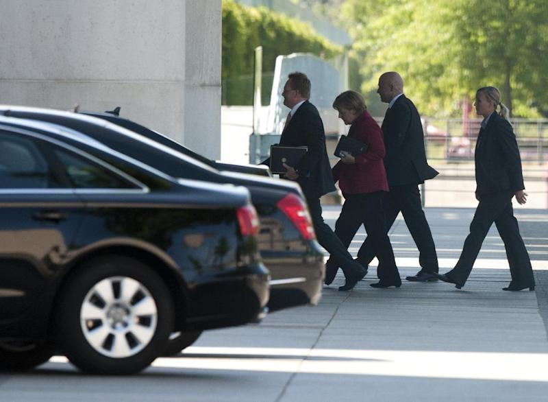"""German chancellor Angela Merkel, second left, arrives at the chancellery for a meeting with opposition party leaders in Berlin, Thursday May 24, 2012. Germany's opposition leader says Chancellor Angela Merkel has accepted the need to add a separate set of measures promoting growth to the European Union's treaty enshrining fiscal discipline. Merkel and top lawmakers held a meeting Thursday. Sigmar Gabriel told reporters that she and the government """"have moved to accept a pact for growth and investment."""" Merkel's center-right government needs the support of opposition parties to secure a two-thirds majority in Parliament for the legislation to pass. (AP Photo/dapd/Andreas Prost)"""