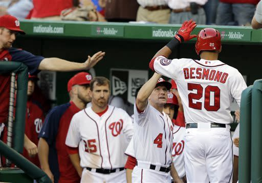 Washington Nationals' Ian Desmond (20) celebrates his solo home run during the second inning of a baseball game against the New York Mets at Nationals Park Tuesday, June 4, 2013, in Washington. (AP Photo/Alex Brandon)