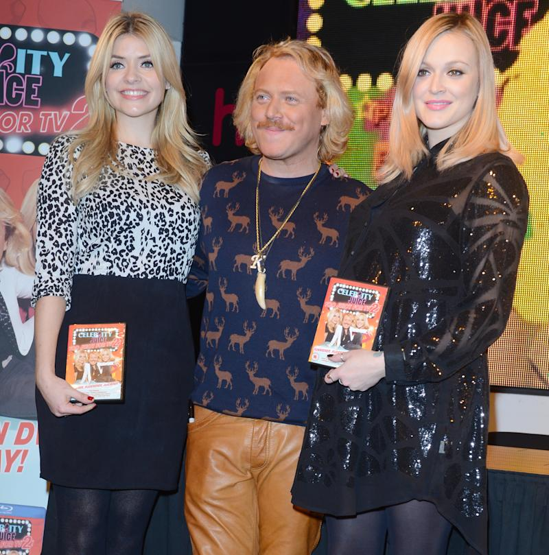 Holly Willoughby, Keith Lemon and Fearne Cotton attend a photo call for Celebrity Juice: Too Juicy For TV 2 at HMV, Oxford Street. (Photo by rune hellestad/Corbis via Getty Images)