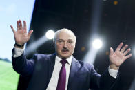 FILE - In this Sept. 17, 2020, file photo, Belarusian President Alexander Lukashenko gestures as he addresses a women's forum in Minsk, Belarus. When Lukashenko became president in 1994, Belarus was an obscure country that had not even existed for three years. Over the next quarter-century, he brought it to the world's notice via dramatic repression, erratic behavior and colorful threats. (TUT.by via AP, File)