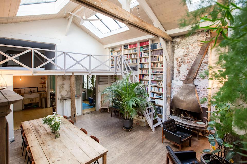 """Have you ever seen a more inviting two-story bookshelf? (Check the reviews of this place—we've also never seen so many exclamation points from happy travelers.) This 10th-arrondissement loft sleeps up to 11, but there are clearly enough nose-in-a-book options if you're feeling anti-social. $367, Airbnb (Starting Price). <a href=""""https://www.airbnb.com/rooms/2749954"""" rel=""""nofollow noopener"""" target=""""_blank"""" data-ylk=""""slk:Get it now!"""" class=""""link rapid-noclick-resp"""">Get it now!</a>"""