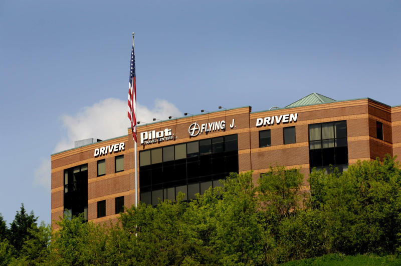 FILE -- An April 30, 2013, file photo shows the Pilot Flying J corporate offices in Knoxville, Tenn. A third employee of the truck stop chain owned by Jimmy Haslam, owner of the Cleveland Browns, and Tennessee Gov. Bill Haslam, pleaded guilty Tuesday, June 18, 2013, in what authorities call a scheme to cheat trucking firms out of rebates. (AP Photo/News Sentinel, Michael Patrick, File)