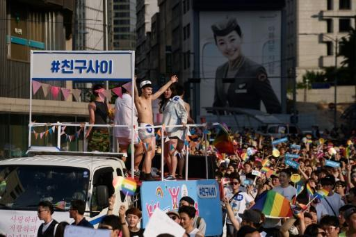 Gay rights supporters parade amid rain, protests in Seoul