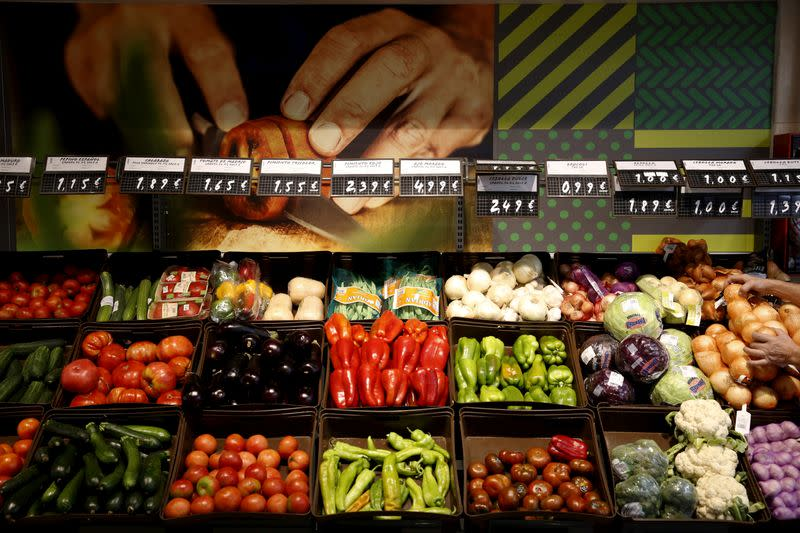 FILE PHOTO: Vegetables are on display at a fruits and vegetable stand at the Plaza de Dia market in Madrid, Spain
