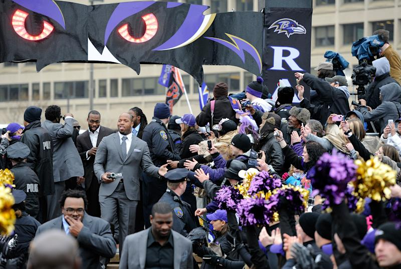 Baltimore Ravens linebacker Terrell Suggs and receiver Anquan Boldin, back, arrive at a send-off rally Monday, Jan. 28, 2013 in Baltimore. The team was leaving for New Orleans to play against the San Francisco 49ers in the Super Bowl. (AP Photo/Steve Ruark)