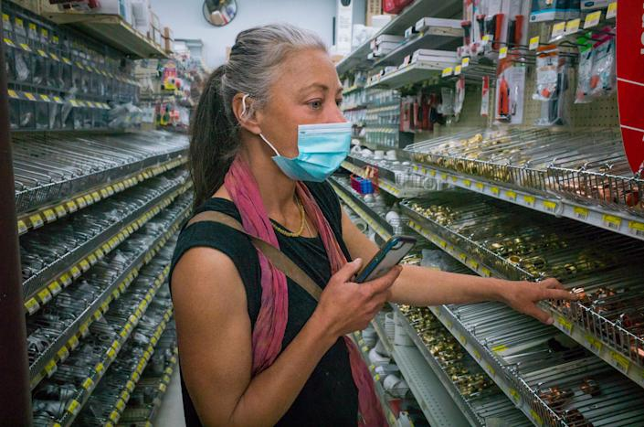 """Paula looks for parts for a heater in a local hardware store on March 3.<span class=""""copyright"""">Nina Riggio for TIME</span>"""