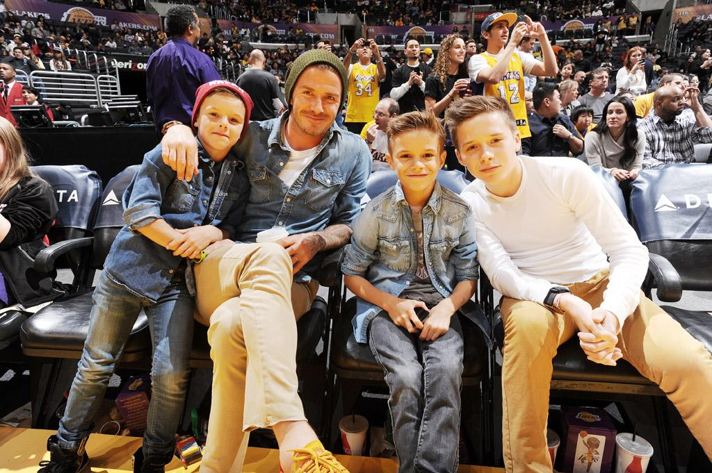 LOS ANGELES, CA - NOVEMBER 16: Los Angeles Galaxy player David Beckham and his sons attend a game between the Phoenix Suns and the Los Angeles Lakers at Staples Center on November 16, 2012 in Los Angeles, California. NOTE TO USER: User expressly acknowledges and agrees that, by downloading and/or using this Photograph, user is consenting to the terms and conditions of the Getty Images License Agreement. Mandatory Copyright Notice: Copyright 2012 NBAE (Photo by Andrew D. Bernstein/NBAE via Getty Images)