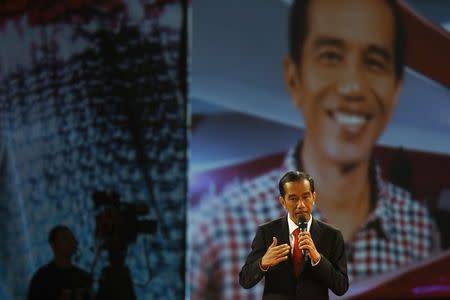 Indonesia's presidential candidate Joko Widodo speaks during a televised debate with his opponent Prabowo Subianto in Jakarta