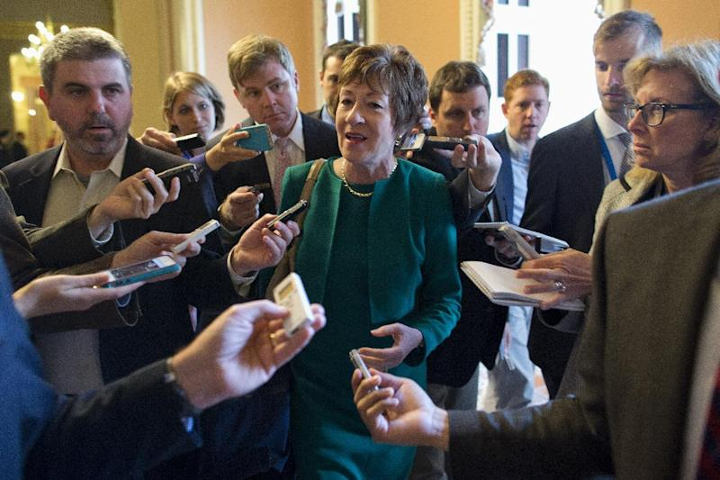 Sen. Susan Collins, R-Maine, talks with reporters after arriving on Capitol Hill in Washington, Friday, Oct. 11, 2013, following a meeting between Republican senators and President Obama at the White House on the ongoing budget battle. Republicans from the House of Representatives were offering to pass legislation to avert a potentially catastrophic default and end the 11-day partial government shutdown as part of a framework that would include cuts in benefit programs, officials said Friday. But the impasse was not yet over. (AP Photo/ Evan Vucci)