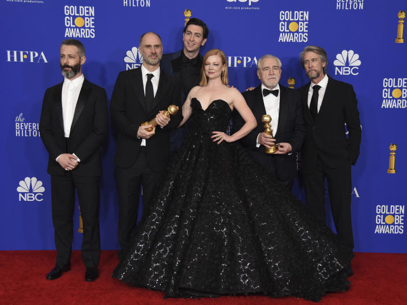 "Jeremy Strong, from left, Jesse Armstrong, Nicholas Braun, Sarah Snook, Brian Cox, and Alan Ruck, from the cast and crew of ""Succession,"" pose in the press room with the award for best television series, drama, at the 77th annual Golden Globe Awards at the Beverly Hilton Hotel on Sunday, Jan. 5, 2020, in Beverly Hills, Calif. (AP Photo/Chris Pizzello)"